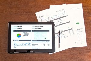 Tablet with charts on on table